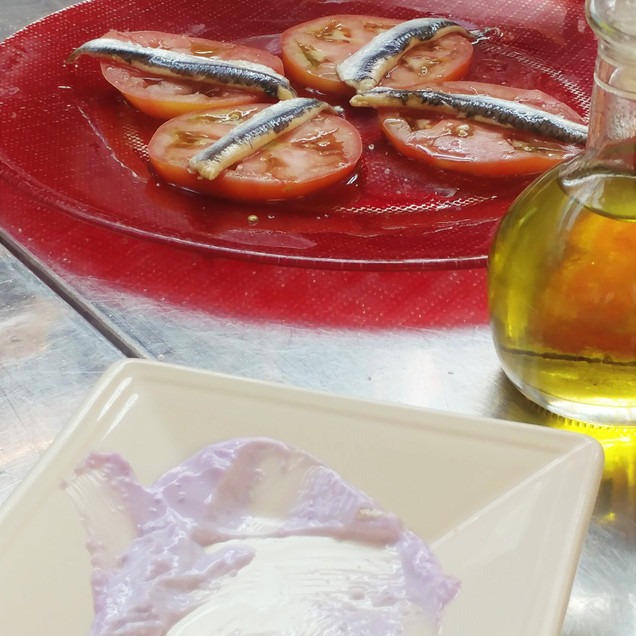 Fish and tomatoes, purple aioli