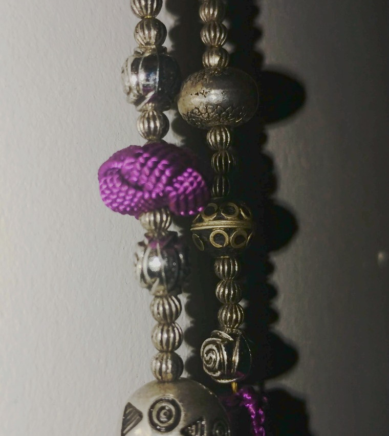 Thread, bead, and button necklace
