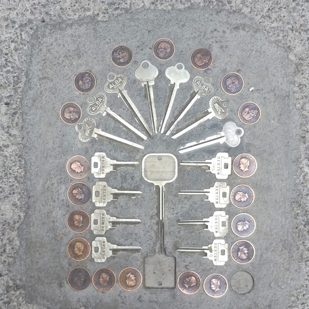 Keys and coins in Condesa sidewalks