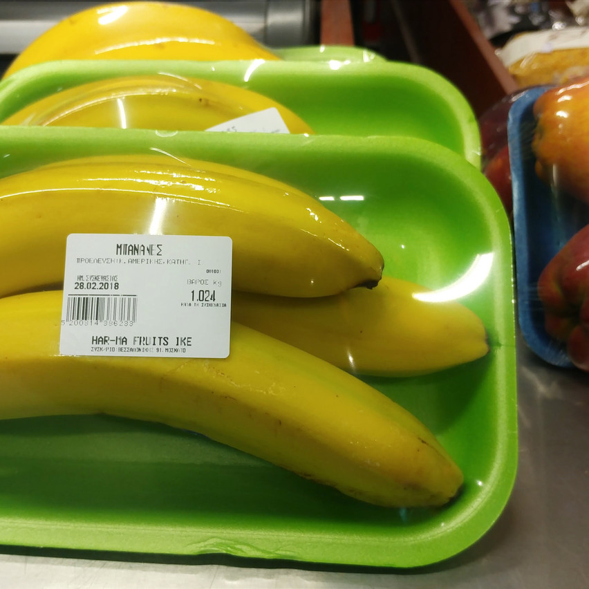 Packaged bananas and apples