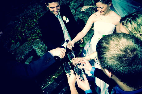 Bride, groom, wedding party pouring champagne toast