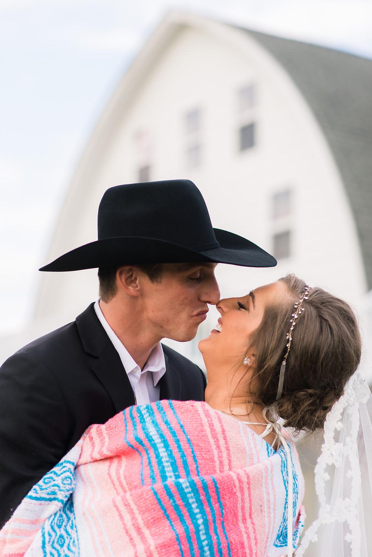 Vanderwende Acres Dairy Barn turned stunning wedding venue kissing bride and groom