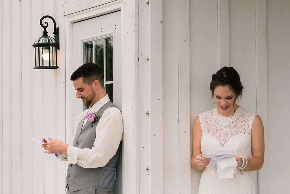 Kylan Barn bride and groom reading letters to each other on Marylands Eastern shore.