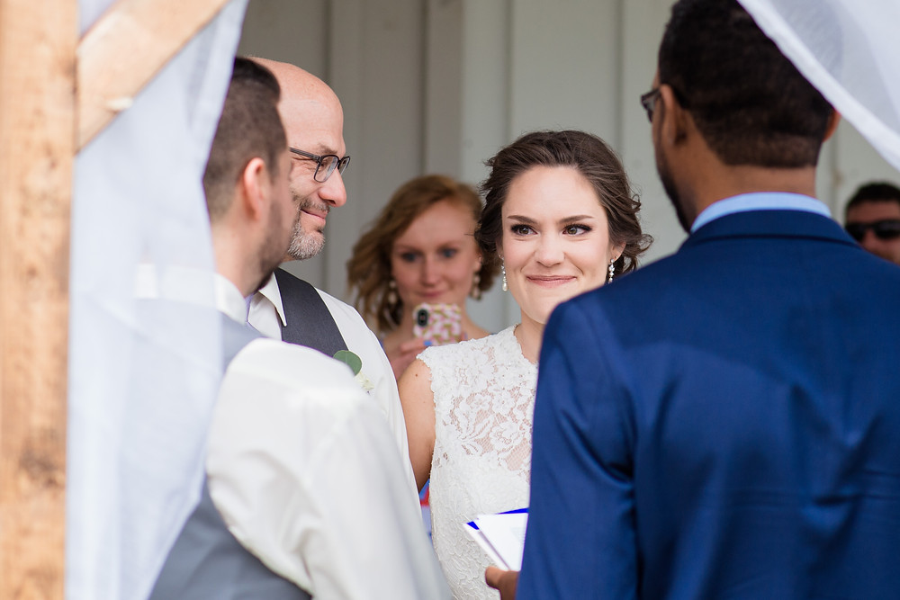 Dad handing off his daughter both dad and bride smiling for what is to come at Kylan Barn Maryland