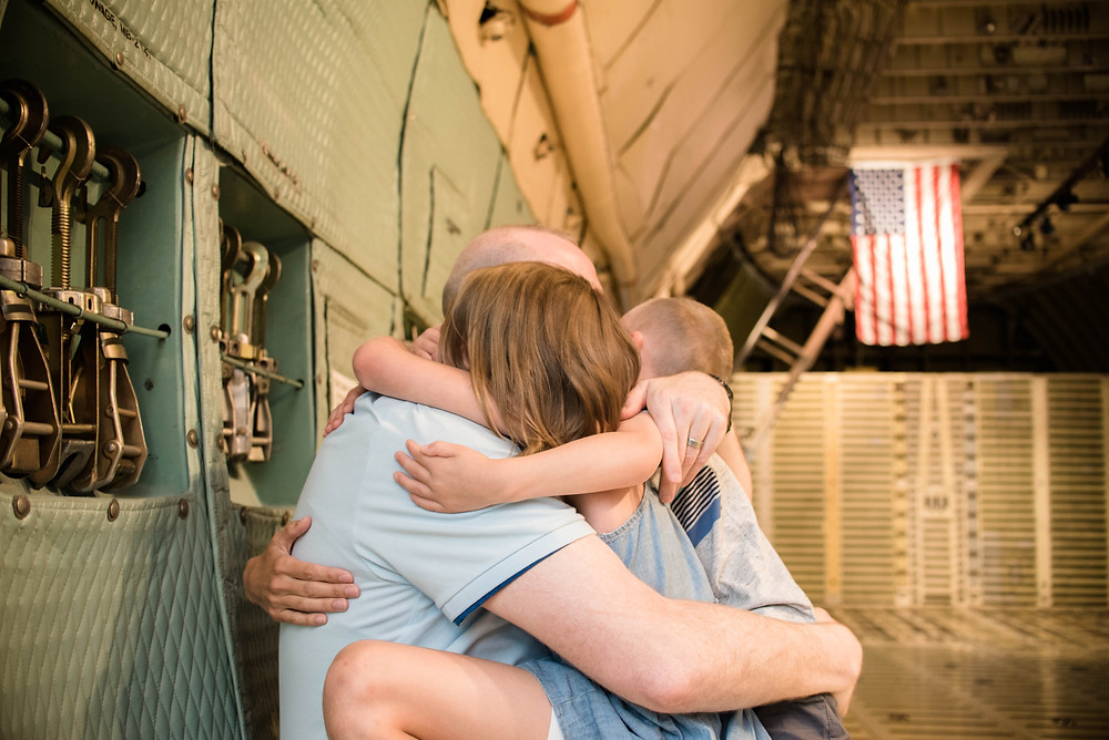 American flag military family welcome home session dover delawarethat was reunited after dad's year long deployment.
