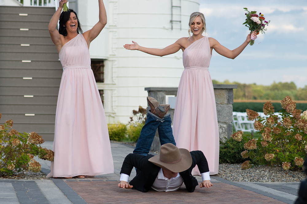 Groomsmen does the worm at rodeo themed wedding at Vanderwende Acres Sussex, Delaware