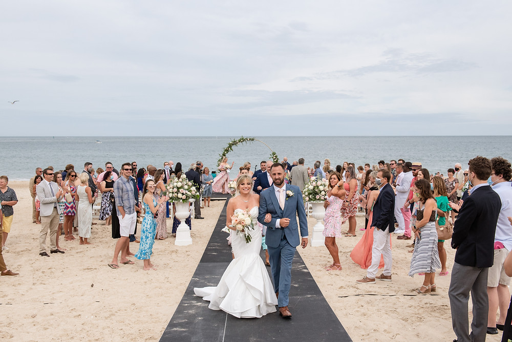 bride and groom on Delaware's beaches getting married surrounded by family and friends in the sand.