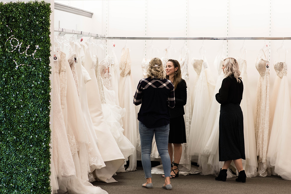 Laura and Donna assisting bride at their Cherry Hill bridal boutique wedding dresses