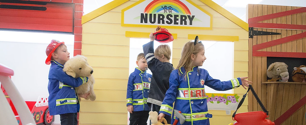 Children enjoying a role play session at Petite Street Playtown