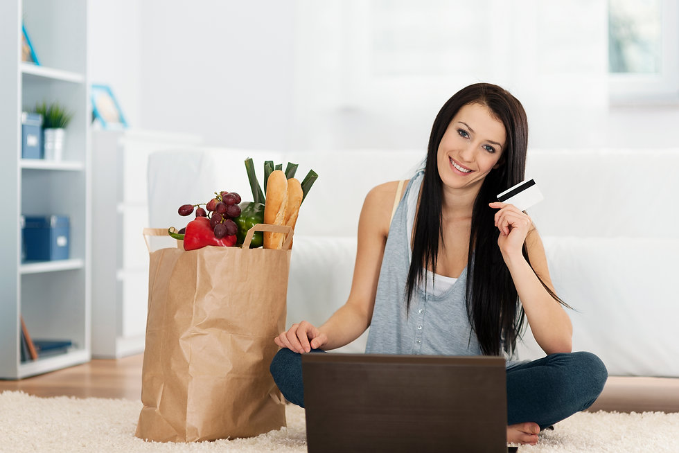 young-woman-buying-groceries-online.jpg