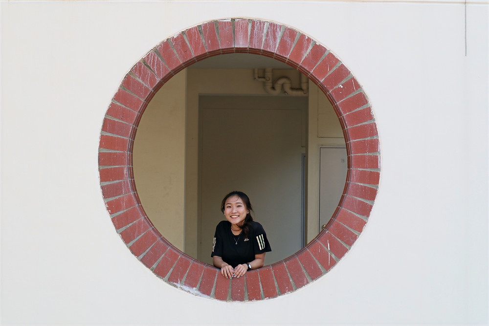 Porthole-shaped opening at the void deck of HDB in Pasir Ris
