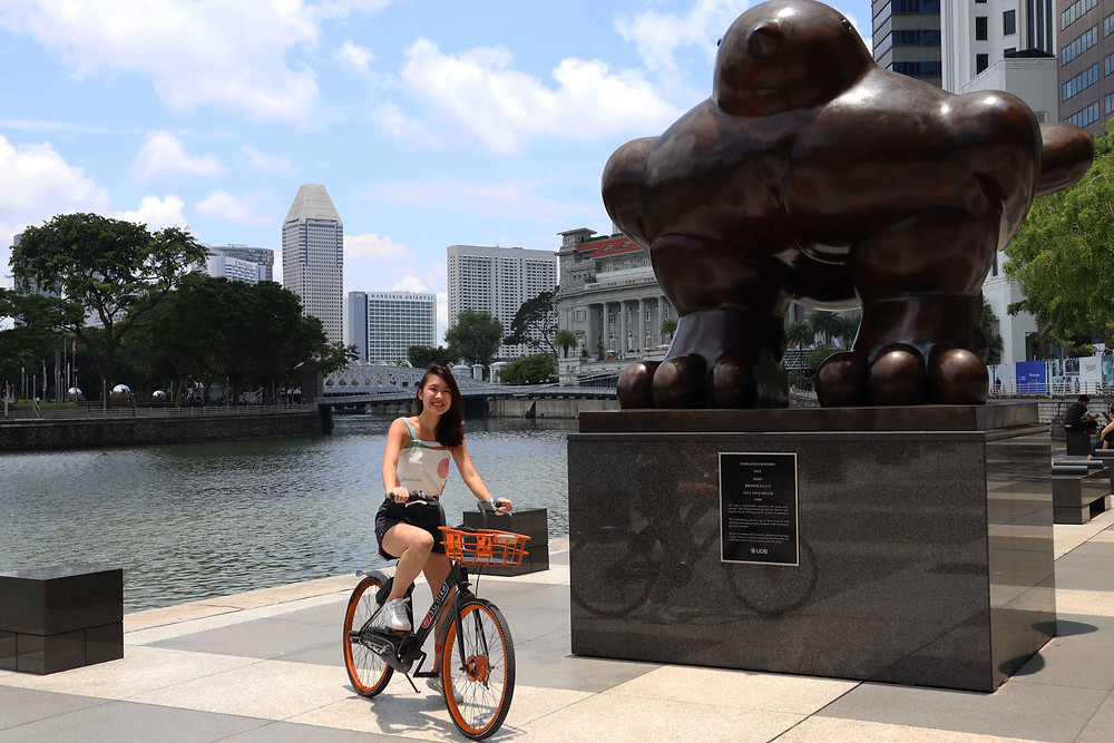 Girl on SG Bike next to Fat Pigeon
