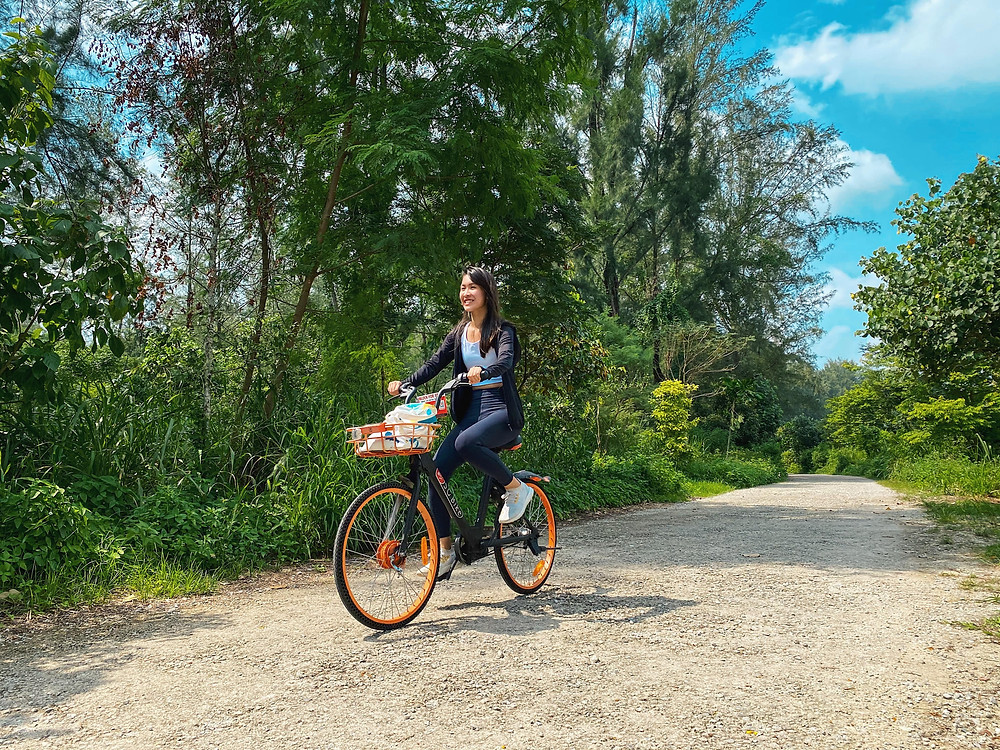 Girl cycling in Coney Island