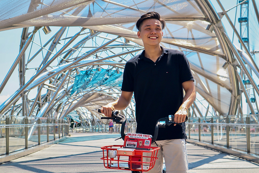 Posing with a bicycle at the Helix Bridge for Instagram
