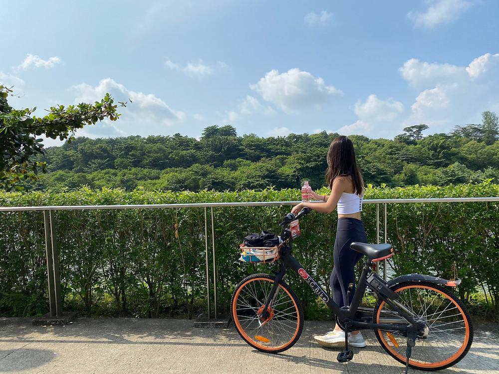 Drinking water with bicycle along Punggol Promenade Riverside Walk