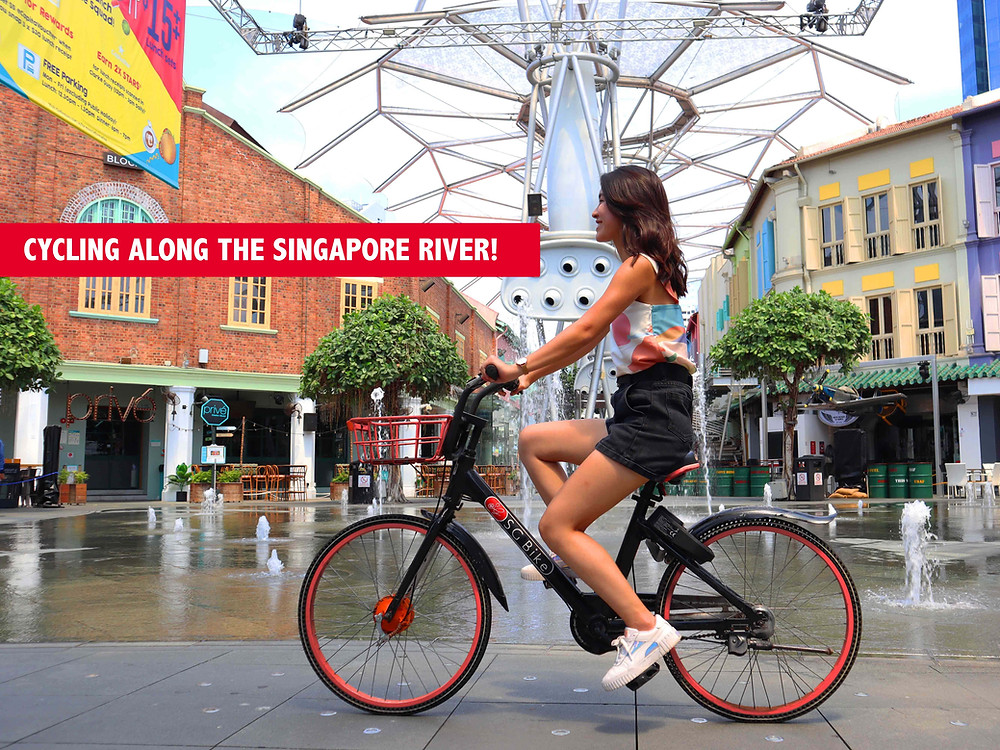 Girl Cycling SG Bike at Clarke Quay