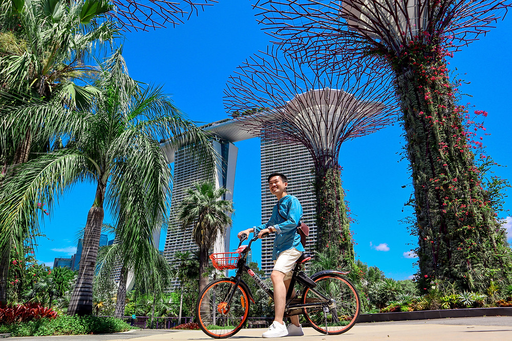 Posing with bicycle in front of Marina Bay Sands and Supertree Grove