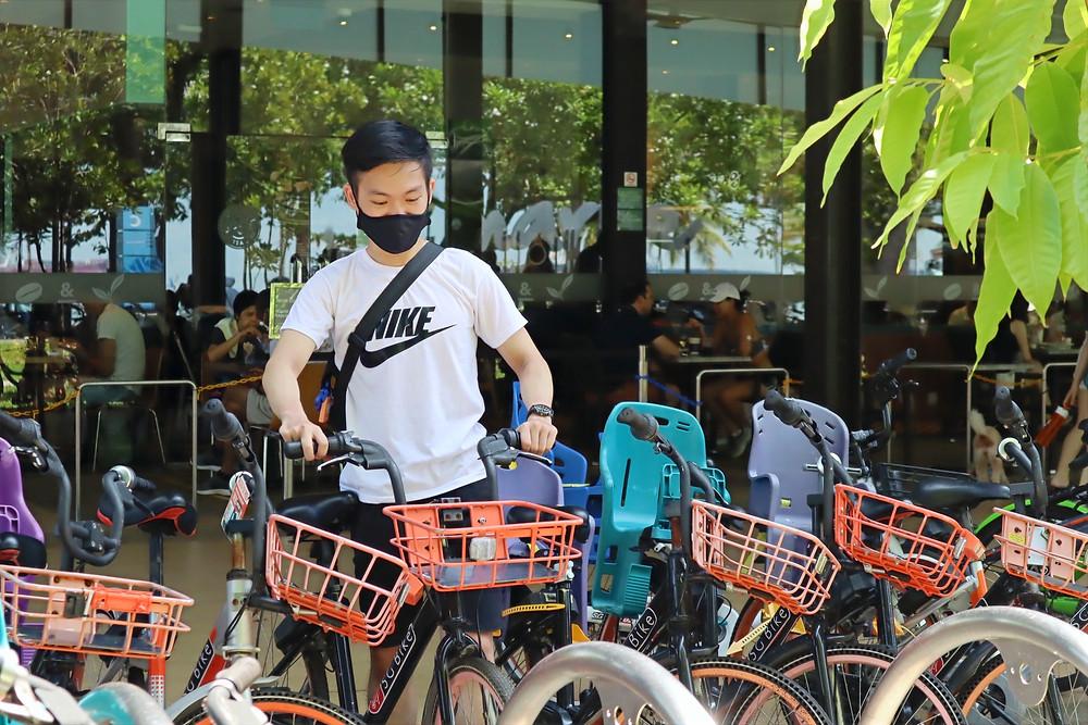 Guy pushing SG Bike