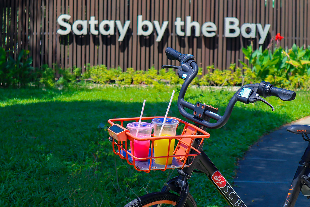 Bandung and Sugarcane drink placed in basket of SG Bike in front of Satay by the Bay