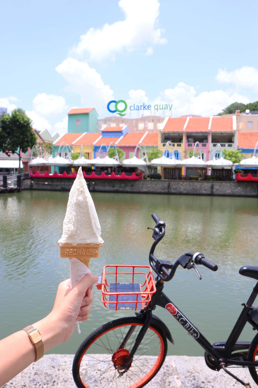 Girl holding ice cream opposite Clarke Quay
