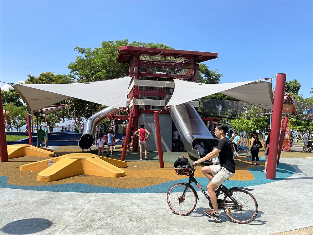 Guy cycling SG Bike at playground at Marine Cove