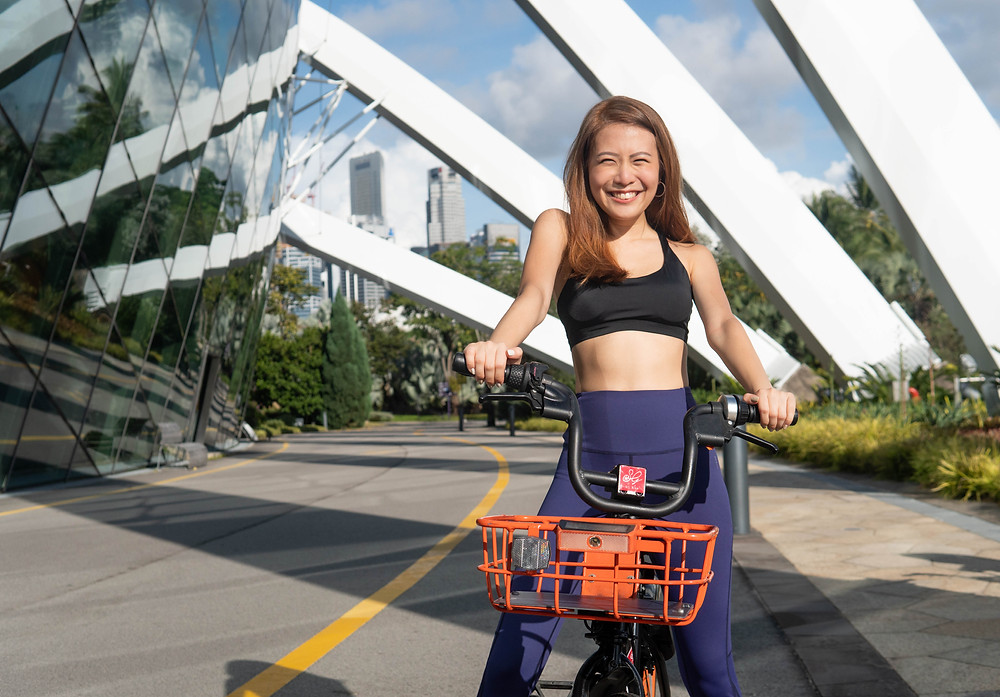 Girl cycling happily