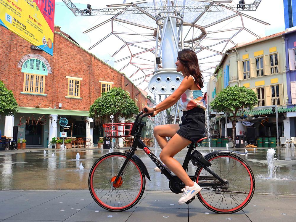 Girl cycling on SG Bike in Clarke Quay