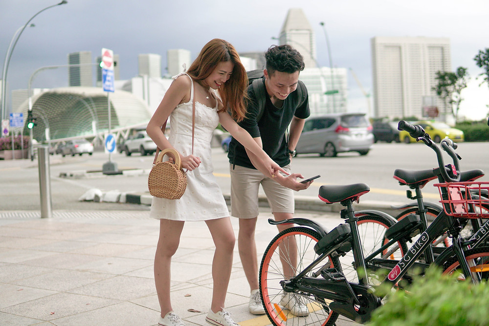 A guy and a girl using SG Bike