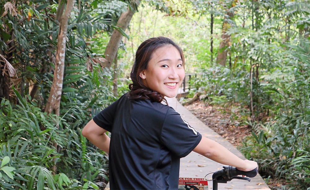 User pushing SG Bike bicycle on the boardwalk at Pasir Ris Mangrove Forest