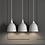 Thumbnail: Variable Pendelleuchte aus Metall und Holz in grau oder schwarz