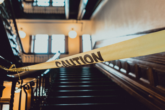 caution-tape-in-front-of-stairs-PLUV6UJ.