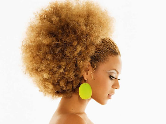 Afro hairstyle made with vibration hairpieces by hothairpieces.com
