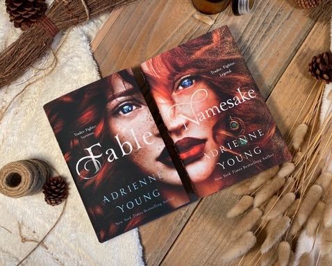 """Marenda frequently posts about books in the fantasy and young adult literature genres, such as """"Fable"""" and """"Namesake,"""" two books in the same series by Adrienne Young. (Photo/Olivia Marenda)"""