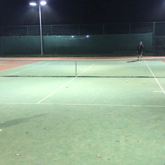 Game based match practice modifiying the court size to provide advantage for the junior.