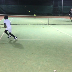 Sean practicing backhand croos court. One of the most basic and common exercices to improve the safest and most used shot in Tennis tactically speaking