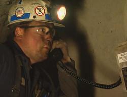 Miner-on-phone-crop.jpg