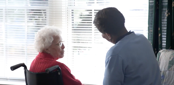 Patient with heart condition speaking with hospice aide.