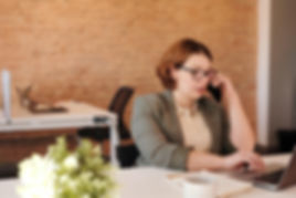 photo-of-woman-talking-through-smartphon