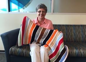 VNA volunteer crochets prayer blankets to bring comfort to hospice patients