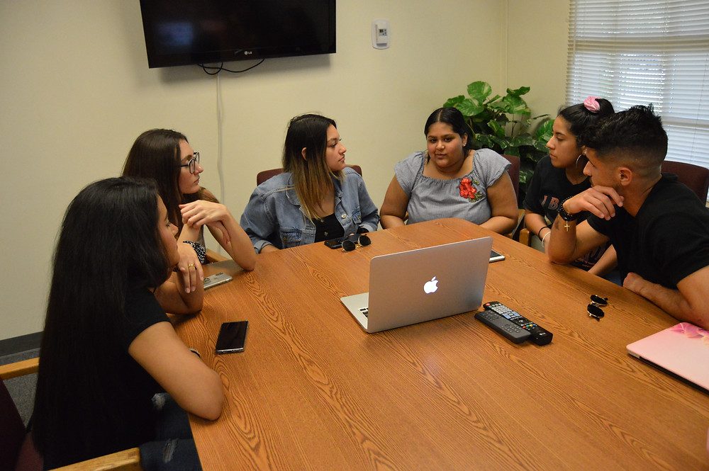 Maria Bolivar-Gomez (President's Assistant), Brittany Perez (Secretary), Kennedy Faña (President), Jada Mohammed (Member), Sarah Ruiz (Assistant Secretary), and Andres Azzolin (Vice President) discussing plans for the women's history event set to take place in March. Not present: Stephanie Fuentes (Treasurer) and Nicole Valdez (Assistant Treasurer).