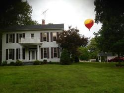Balloon over park house