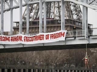 یک زن نیمه برهنه در اعتراض به سفر حسن روحانی به فرانسه خود را حلقهآویز کرد