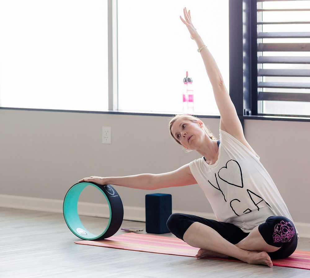 Ann Heckler with wheel at Yogaja Yoga by Mary WYar