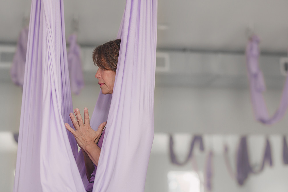 Margaret Penn in aerial hammock at Yogaja Yoga Toledo by Mary Wyar Photography.