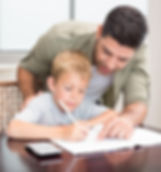 Happy father helping son with math homew