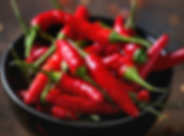 red peppers in a bowl.png