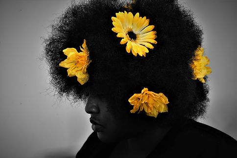 Black and White photograph with yellow flowers in hair