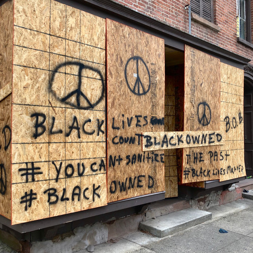 A Black Owned, Boarded-Up Storefront, with the Words ' You can not sanitize the past' Boldly Painted in Black Lettering and Accented with Peace Symbols, Troy, New York,