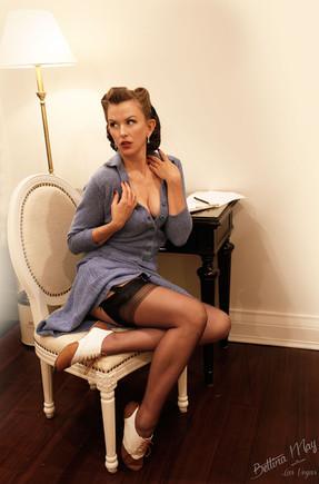 Bettina May as the Secretary