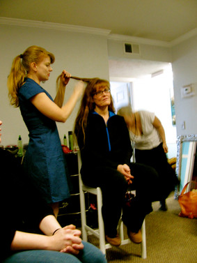 Shay at the beginning of class, getting her hair set by Bettina's assistant April.